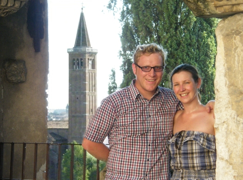 My girlfriend and me, in Verona - shot with a Fuji Finepix S8000fd bridge camera on a self timer (but using two exposures combined for the foreground and background tower: 20mm, ISO 200, f/4, 1/140sec & ISO 1600, f/6.3, 1/2000sec)