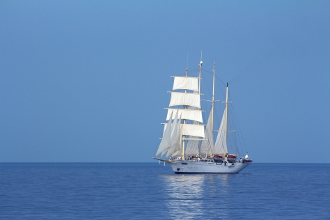 A tall ship spotted from a large ferry between Rhodes and Symi islands in Greece.  We saw the boat from miles away and I have a series from a distant speck to a full broadside. (Canon EOS 650D, 160mm, ISO 100, f/5.6, 1/1000sec)
